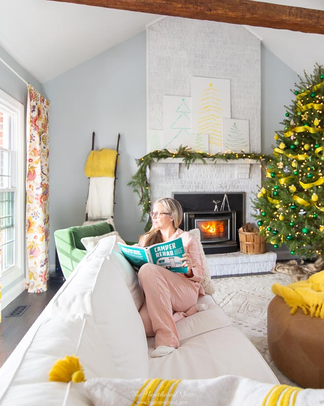 9 tips for winter hygge decor | sitting on white sofa with fireplace in background