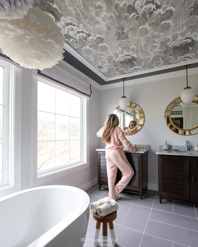 "9 tips for winter hygge decor | Pictured: Positano pjs serena & lily in ""wildrose"" in master bathroom with cloudy sky wallpaper ceiling"