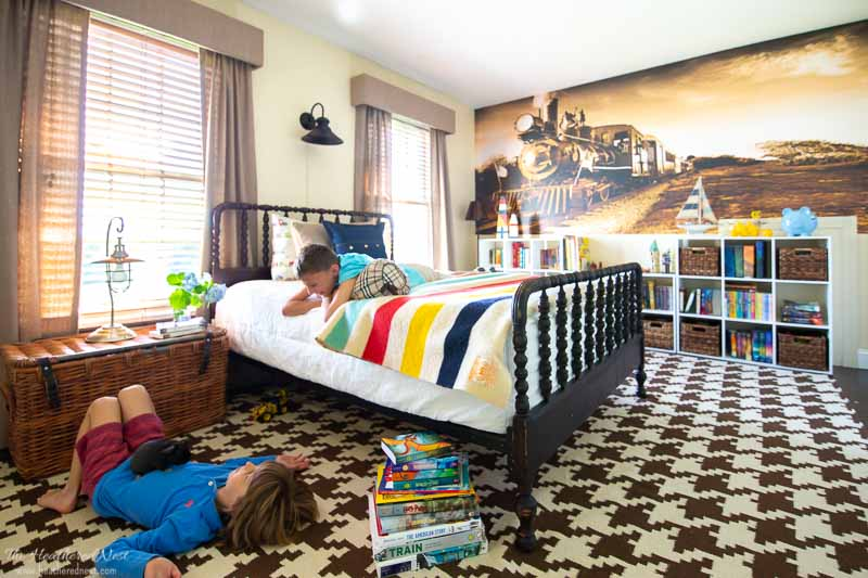 DIY cornice boards shown in a boy's train themed bedroom