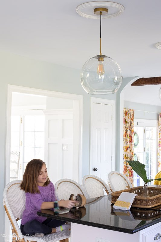 kitchen island lighting update - antique brass and glass globe fixtures from Wayfair