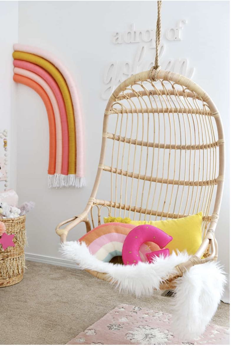 Arin Solange hanging rattan chair in girls bedroom