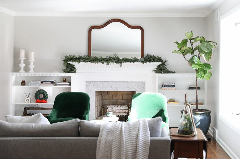 living room painted agreeable gray with a white fireplace