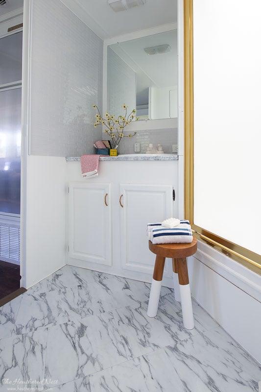 DIY Achim Marble Look Vinyl Tile Installation in a Camper Remodel