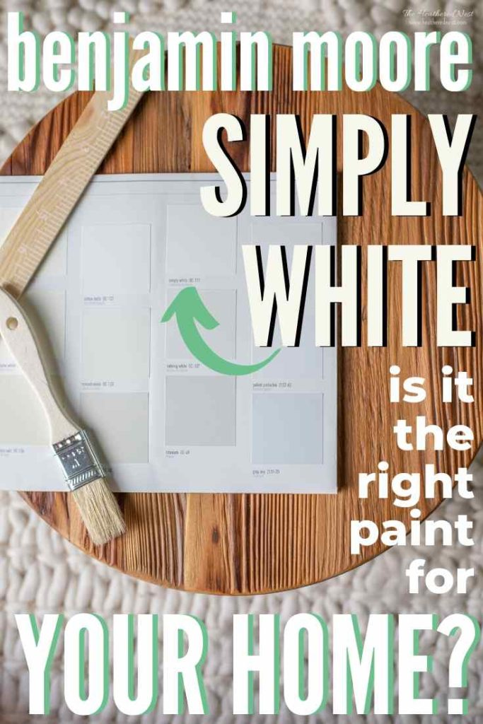Sheet with paint chips including Benjamin Moore Simply White on a wood round.