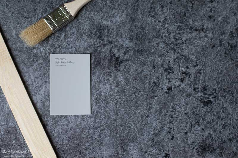 Sherwin Williams Light French Gray on a slate background