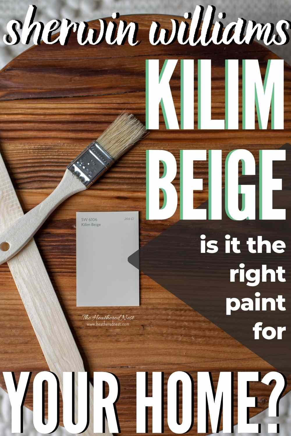 Sherwin Williams Kilim Beige paint swatch next to a paint bush and stir stick