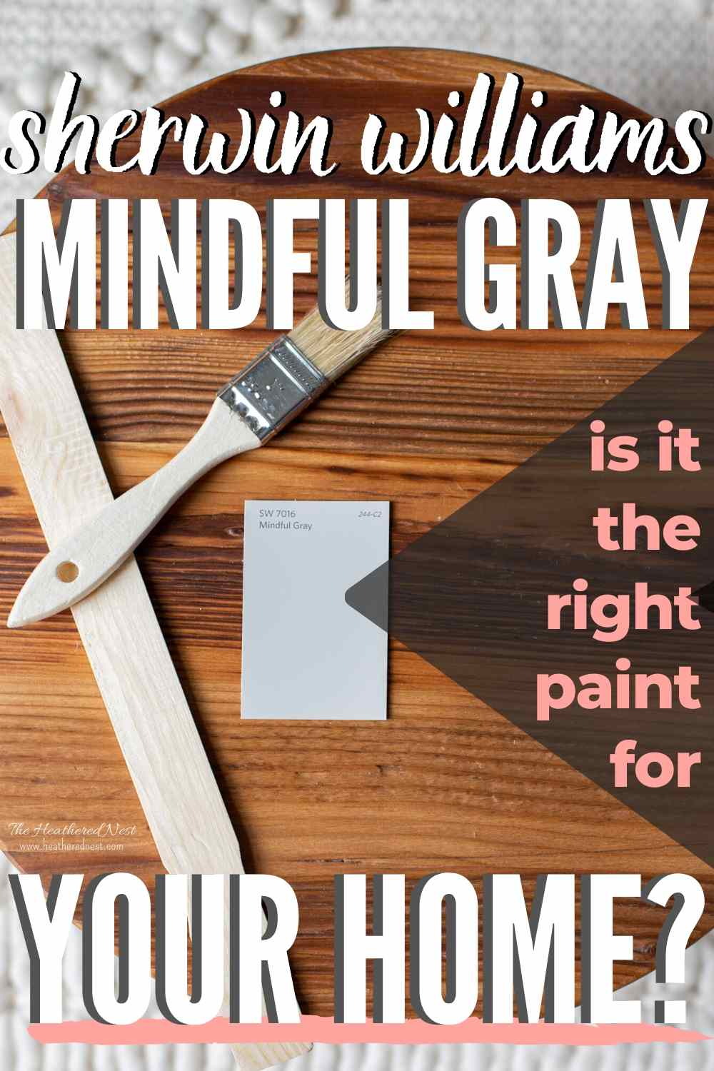 Swatch of mindful gray paint on a wooden round with a stir stick