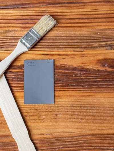 sherwin williams peppercorn on a wooden background