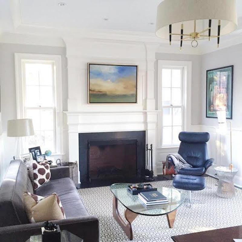 living room with white trim, balboa mist walls and colorful pictures hanging on the walls