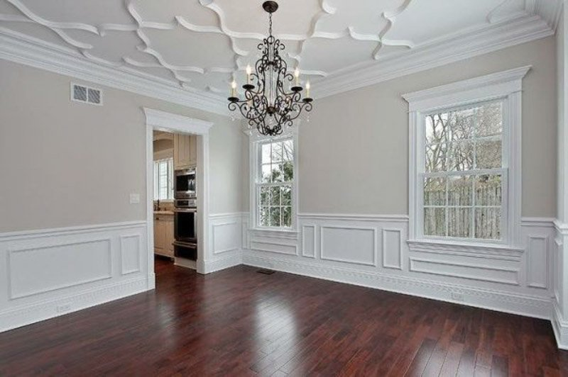 formal dining room with hanging chandelier and no furniture