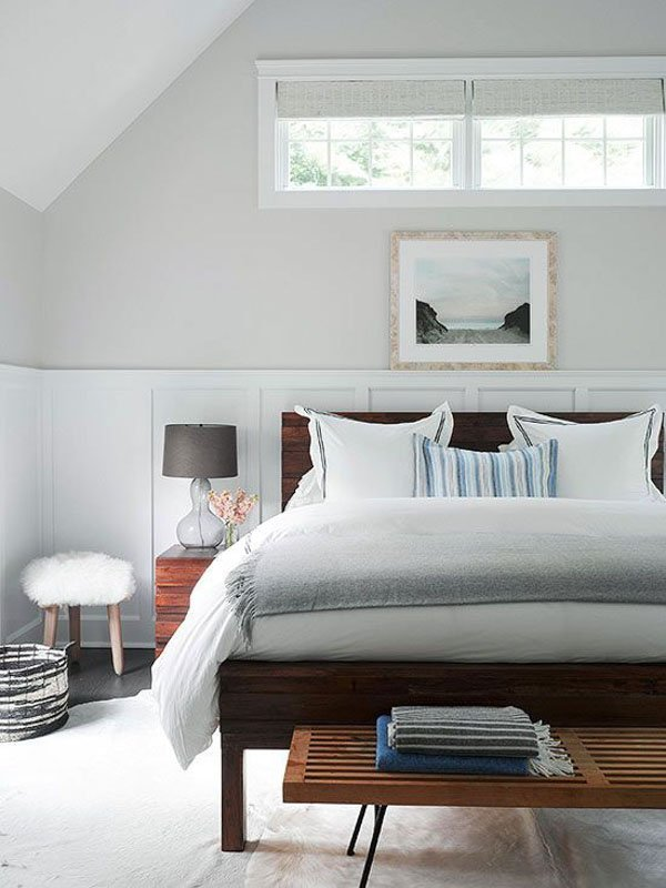 bedroom with bed, balboa mist walls, and white wainscotting