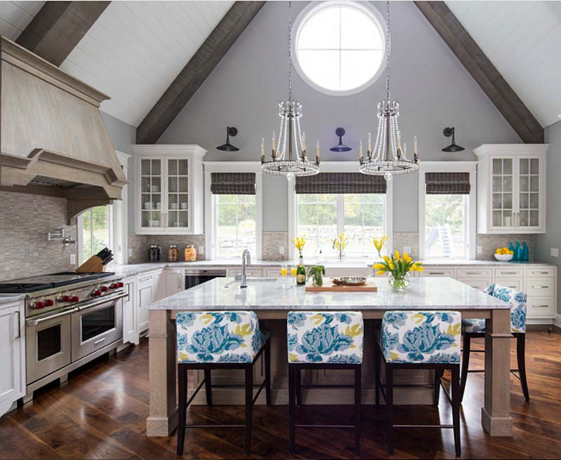 A kitchen with a fireplace and a large window painted in Light French Gray