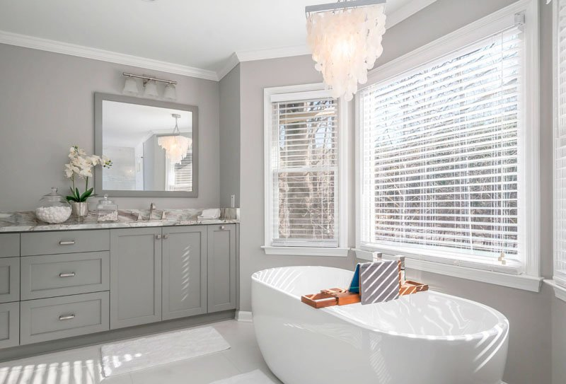 Light French Gray in bathroom with capiz chandelier and vessel tub