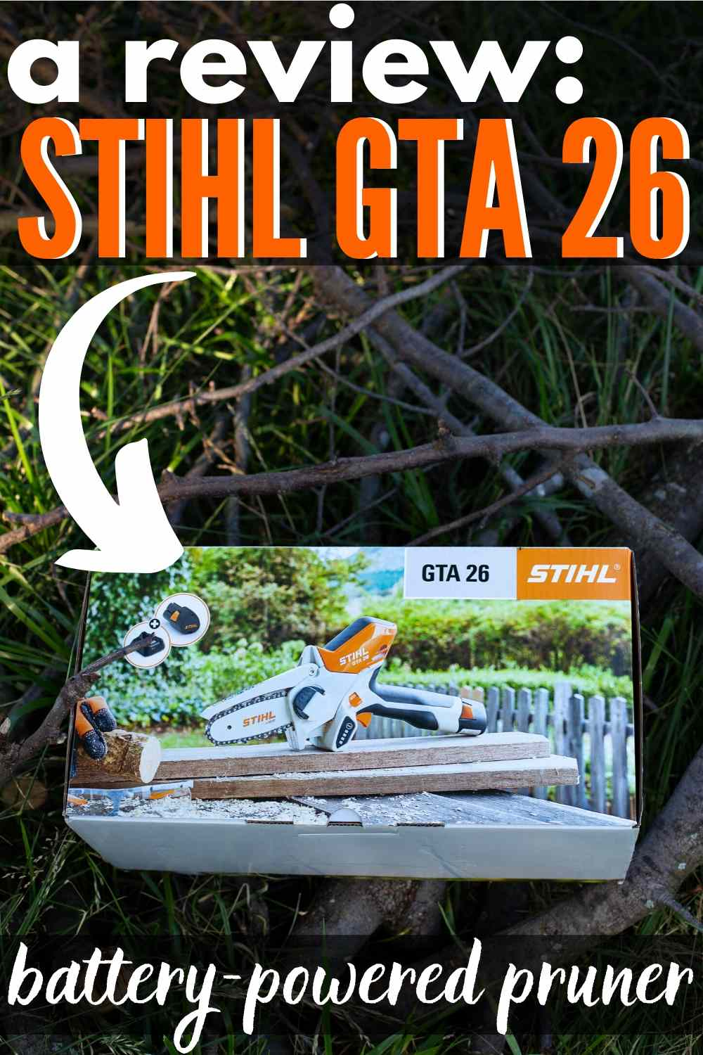 "STIHL GTA 26 in box on some twigs, sticks and yard debris - text ""a review stihl gta 26 battery powered pruner"""