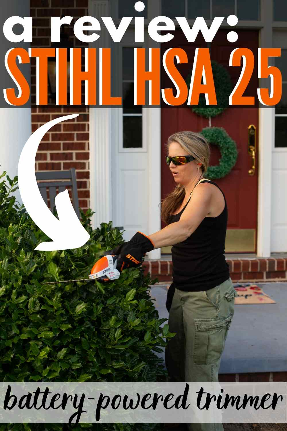 "STIHL HSA 25 in use trimming a large holly hedge in front of brick front home with white columns text ""a review"" STIHL HSA 25 battery-powered trimmer"""