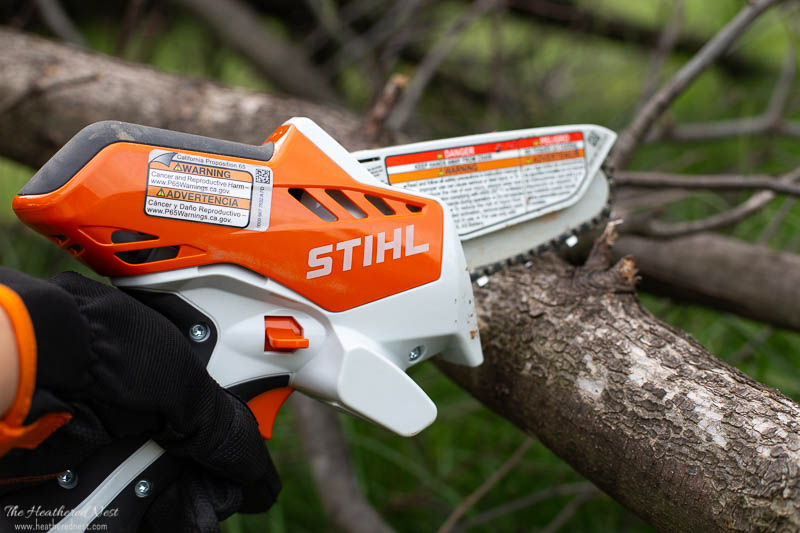 STIHL GTA-26 being used to cut large branch of fallen pear tree