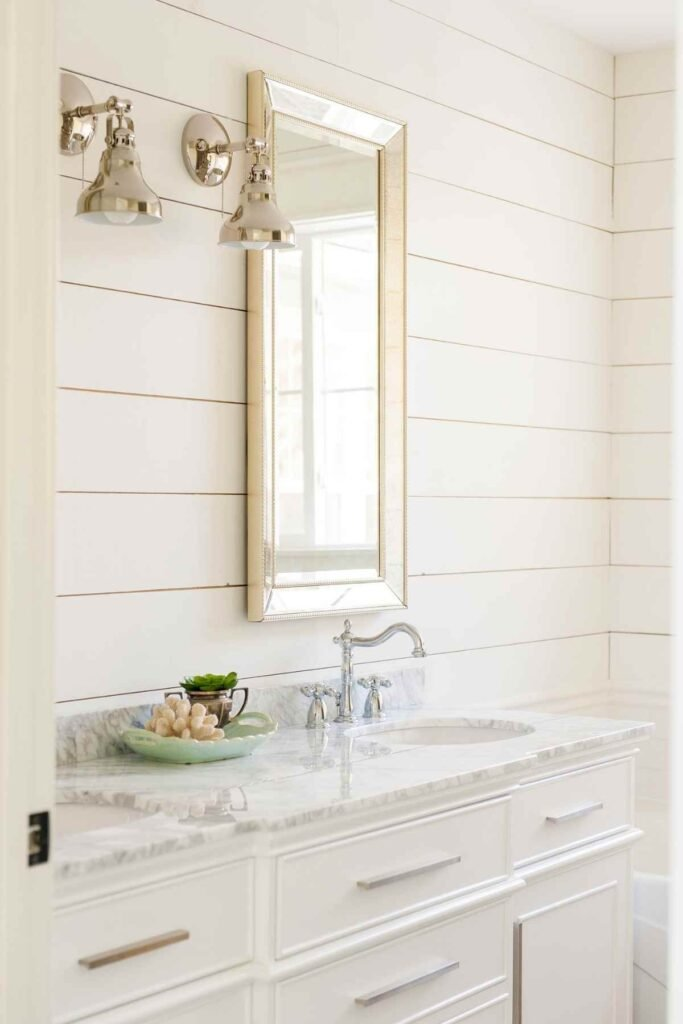 Shiplap in a farmhouse bathroom painted Sherwin Williams Alabaster - Source: Harper House