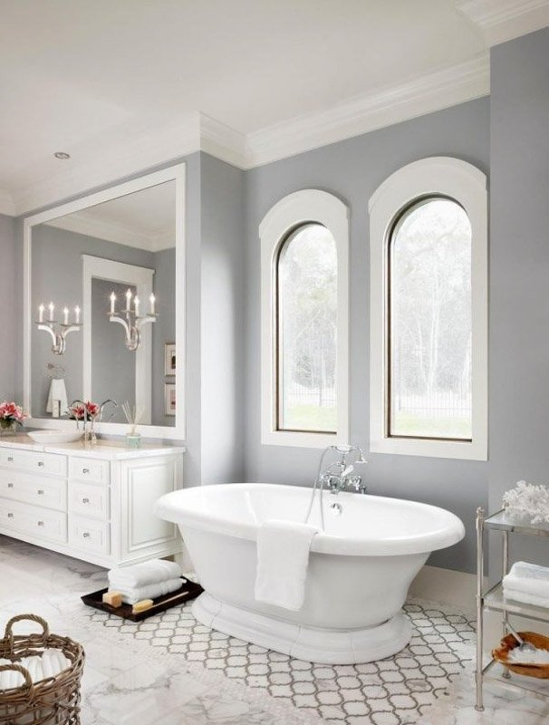 Sherwin Williams Light French Gray in a bathroom with large rounded windows, white vanity and white trim