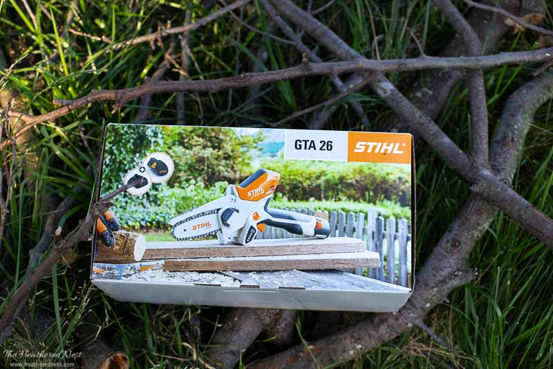STIHL GTA 26 in box on some twigs, sticks and yard debris