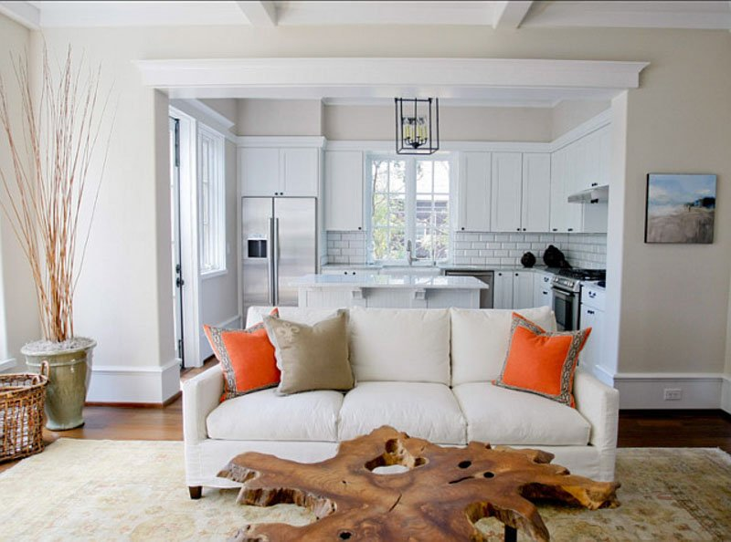 A living room filled with furniture and a large window painted with Dover White paint