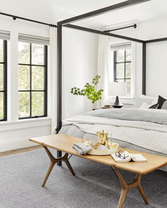soft white bedroom with lots of natural light and black trim & accents
