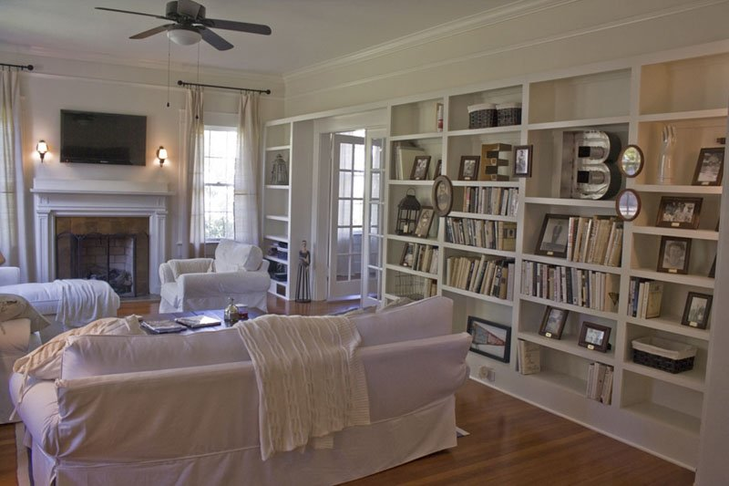 A living room filled with bookcases painted Dover White