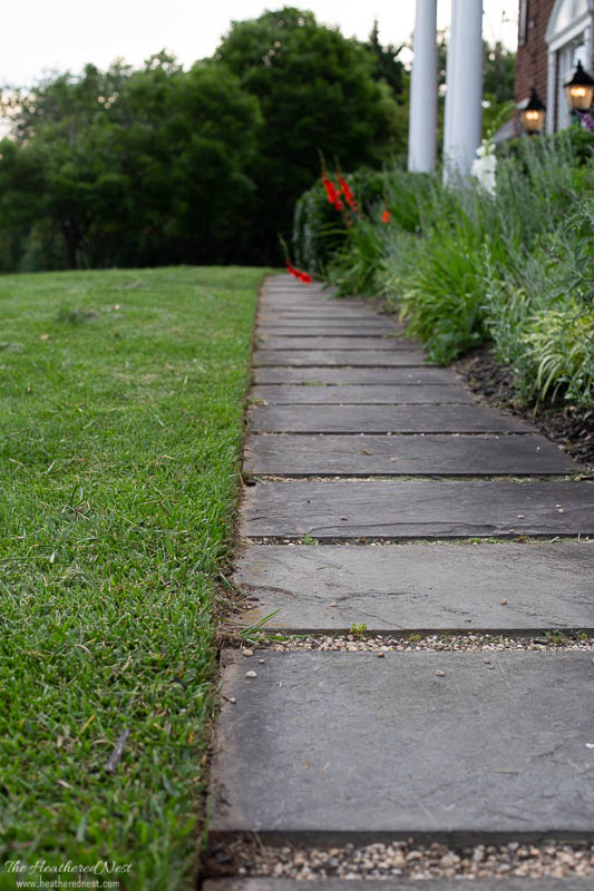 sidewalk after edging with the STIHL battery KombiSystem FCS straight lawn edger attachment tool