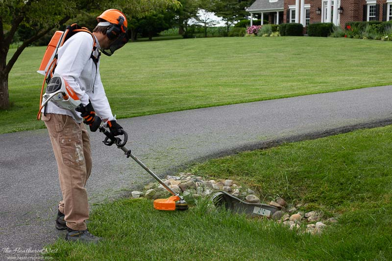 STIHL battery KombiSystem FS-KM Line Head Trimmer Attachment being used