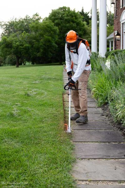 STIHL battery KombiSystem FCS Straight Lawn Edger Attachment being used