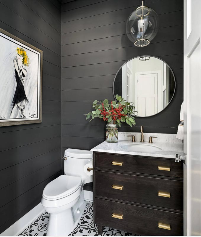 Guest bathroom with with Sherwin Williams Iron Ore shiplap walls.