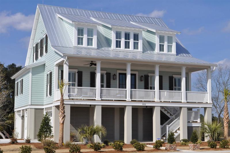 Large, coastal-style home with Sherwin Williams Rainwashed paint exterior and white trim.