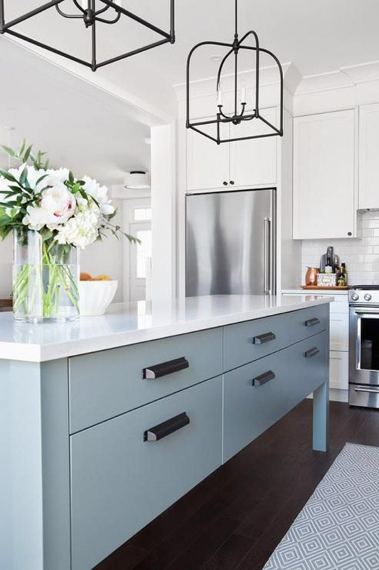 Bright, white kitchen with pale blue kitchen island.