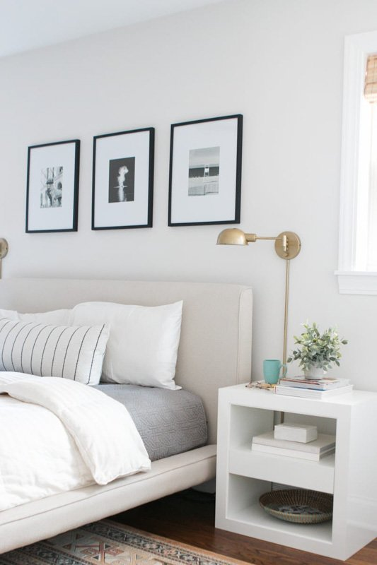 Soft and airy bedroom with neutral color palette and Silver Satin Benjamin Moore walls.