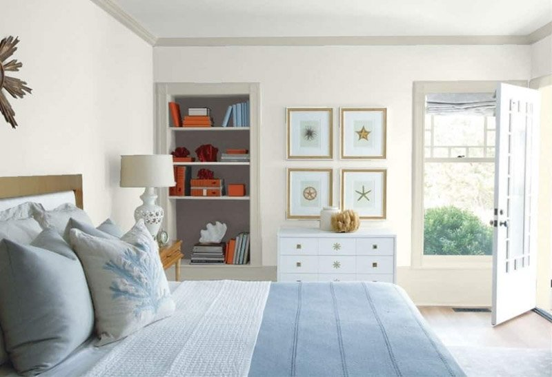 Silver Satin wall color contrasts with gray trim in this bedroom.