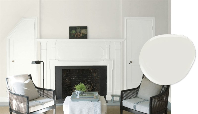 Silver Satin Benjamin Moore on the walls white fireplace and trim, black decor accents.