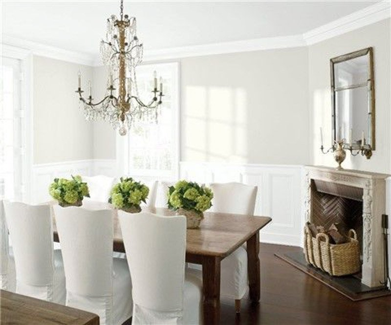 Bright and airy dining room with traditional accents, chandelier and BM Silver Satin on the walls.