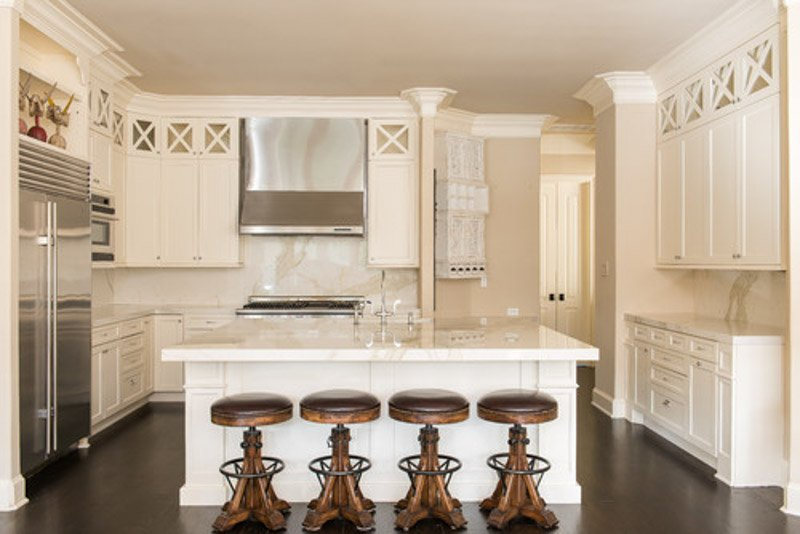 Light and bright kitchen with warm white cabinets and SW Kilim Beige on the walls.
