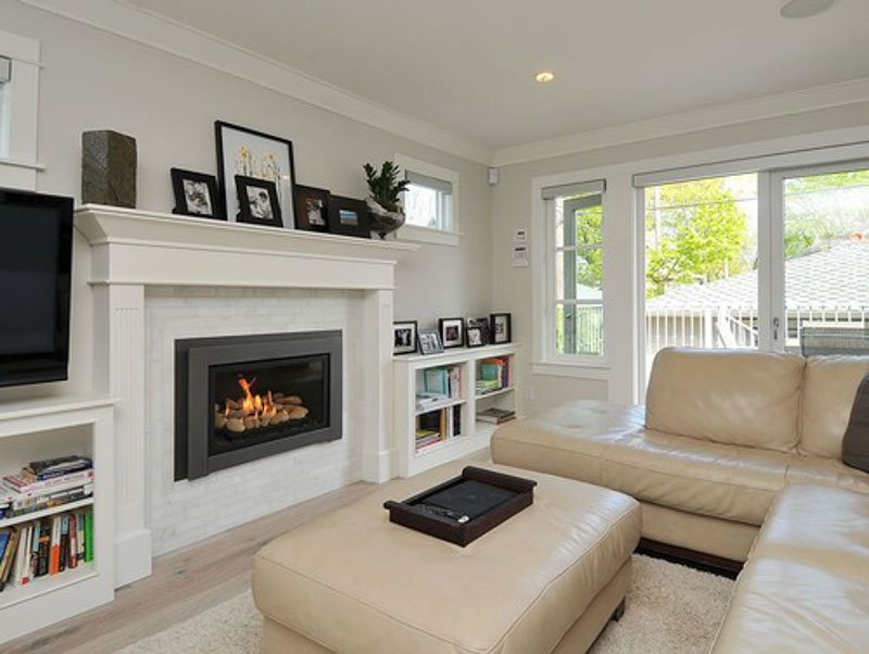 Silver Satin Benjamin Moore on the walls, white fireplace and trim, black decor accents.