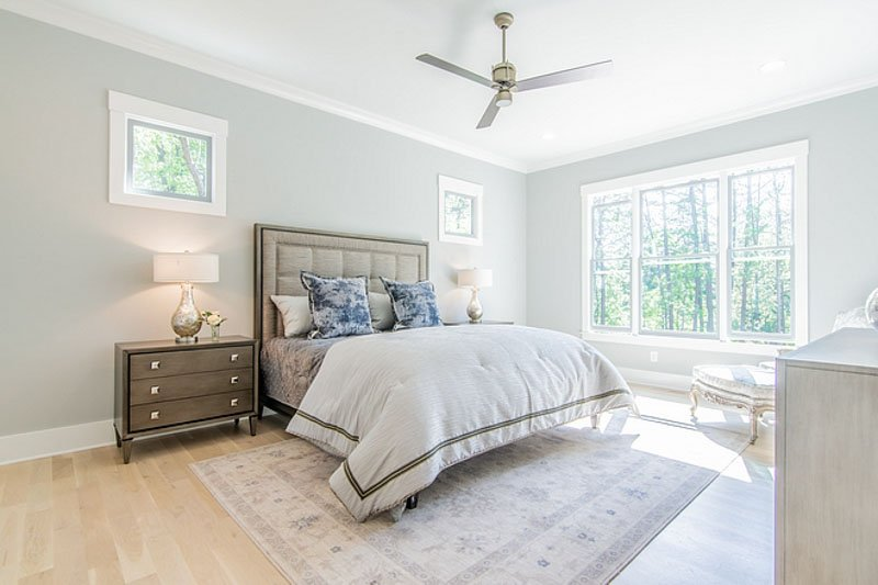 Passive Gray Sherwin Williams in bedroom with bright natural light
