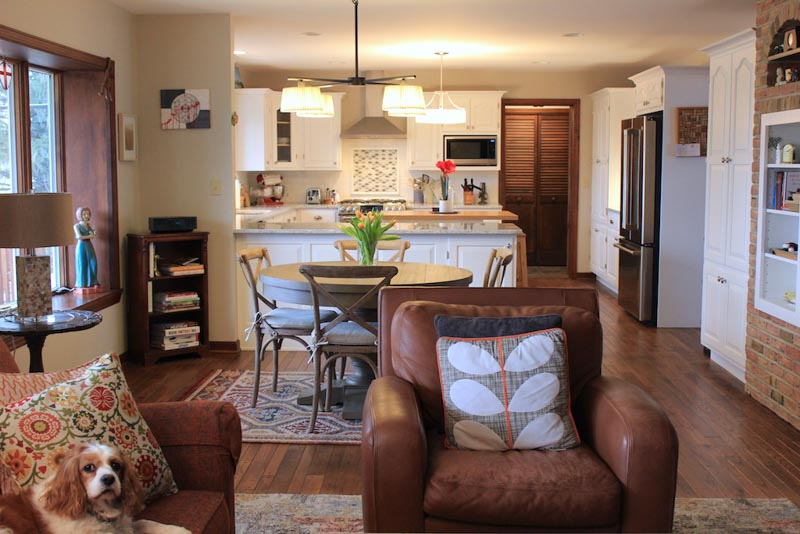 Sherwin Williams Accessible Beige pairs with leather brown accents in an open concept living room/kitchen.