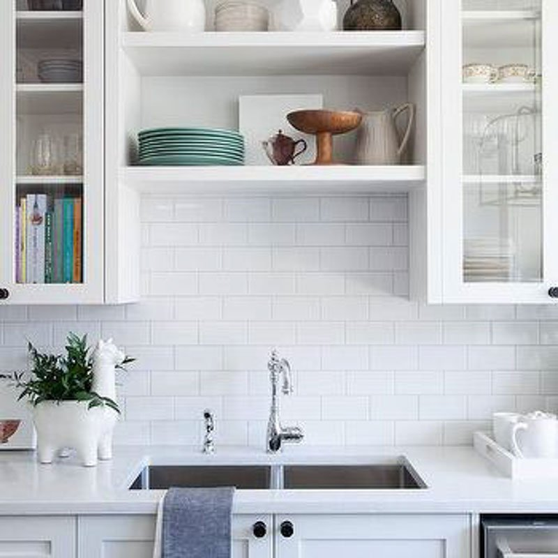 Silver Satin paint looks great on kitchen cabinets with white countertops and white subway tile backsplash.