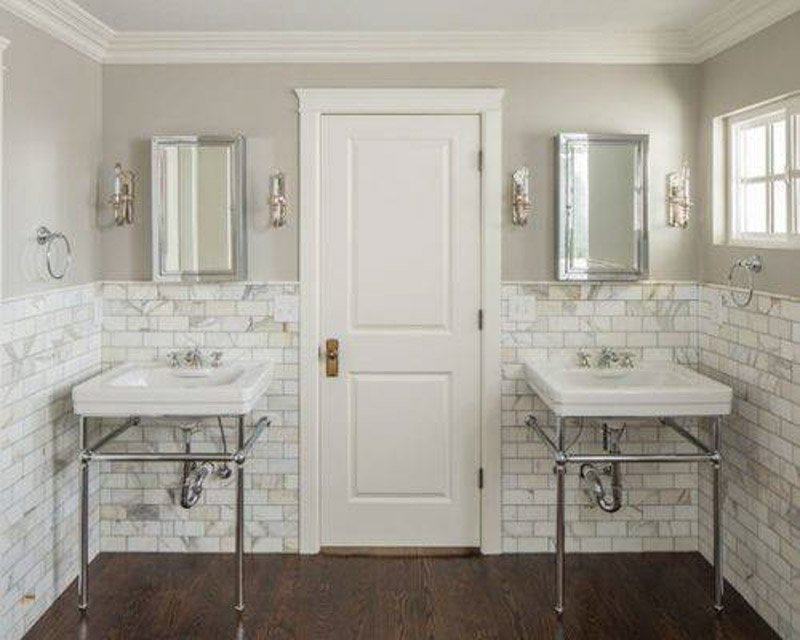 Bathroom with two sinks—the wall behind it is half subway tile with marble, and half Mindful Gray.