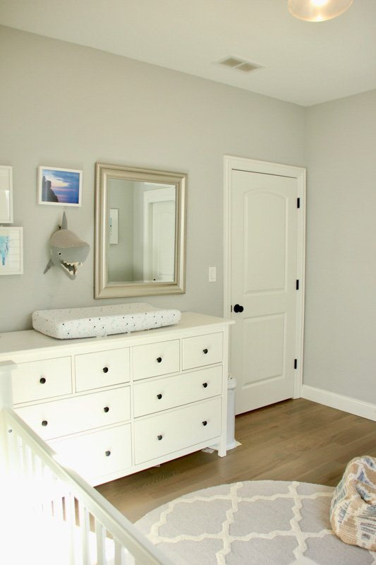 Passive Gray Sherwin Williams in gender neutral nursery with white dresser