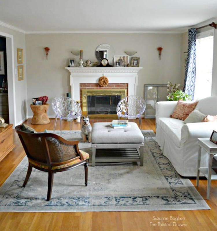 Sitting room with fireplace and walls by Sherwin Williams Accessible Beige
