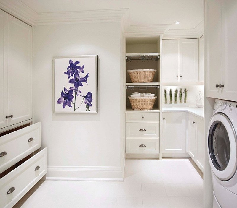 Large, white laundry room with purple flower wall art.