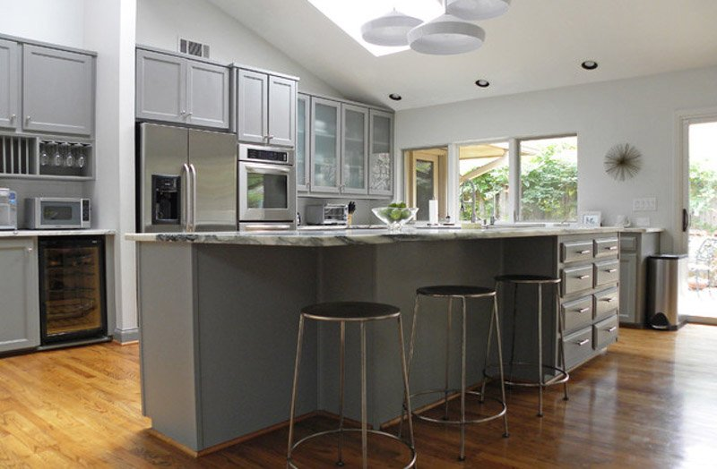 Large, open kitchen with gray cabinets.
