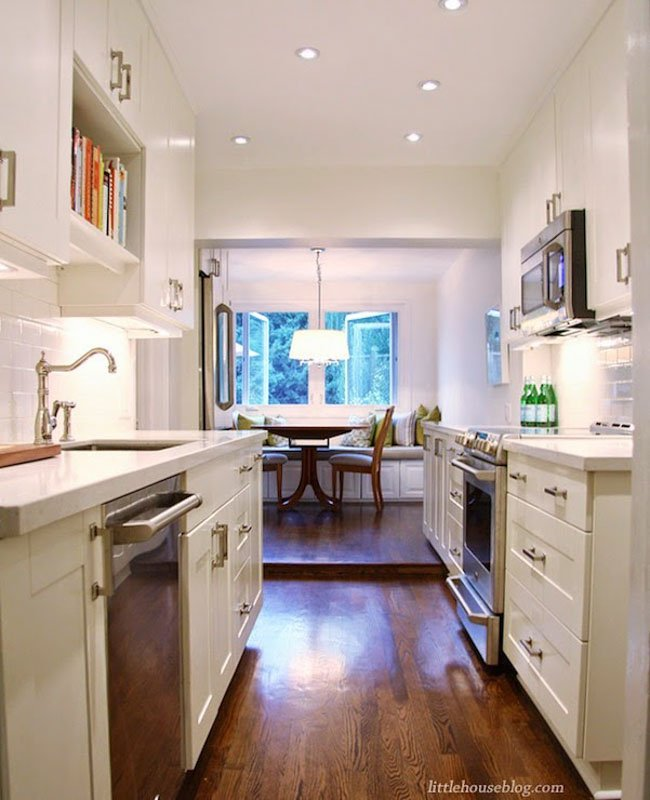 Benjamin Moore Cloud White for a galley kitchen remodel.