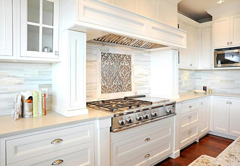 Cloud White paint is a great choice for kitchen cabinets in spaces with warm color palettes