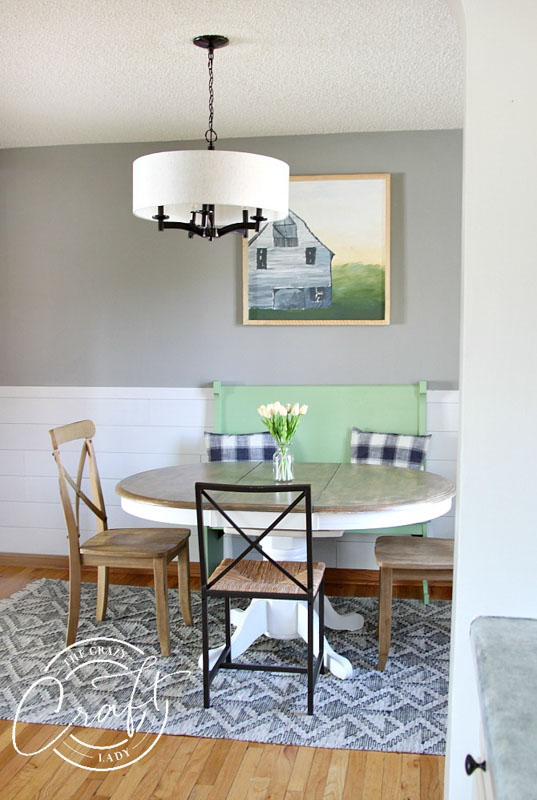Gray walls paired with white ship lap makes a soft dining room backdrop.
