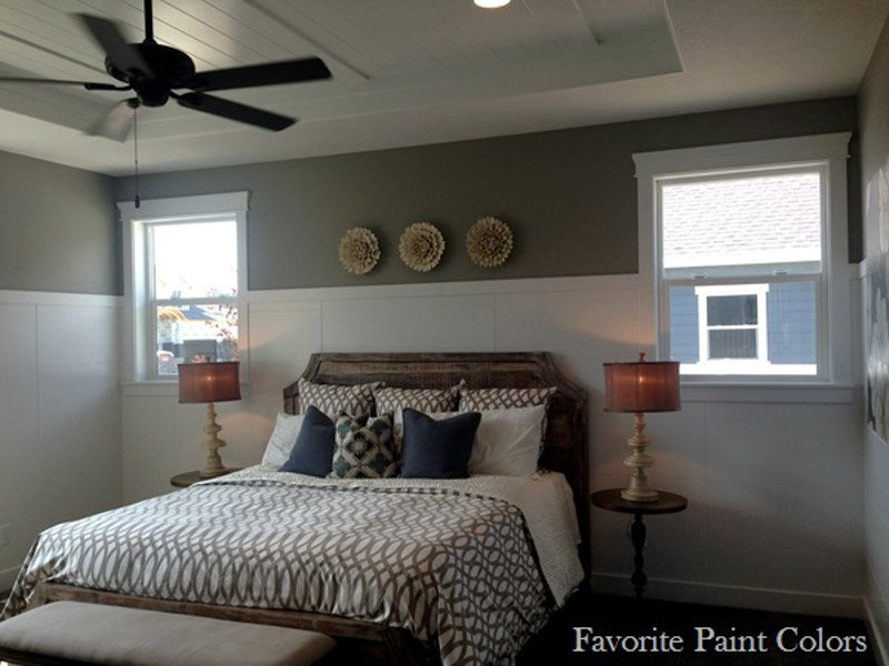 This bedroom features white trim and high board and batten with a small amount of Dorian Gray paint on the walls.